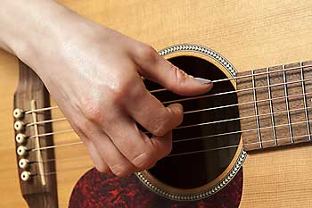Woman playing the guitar.
